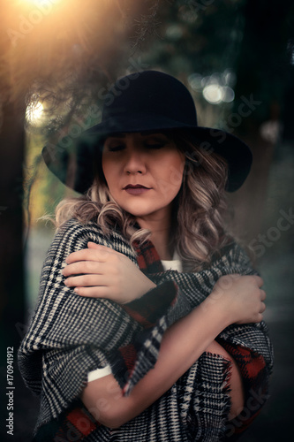 A portrait of a young blond woman warming herself up ed06347cb8ba
