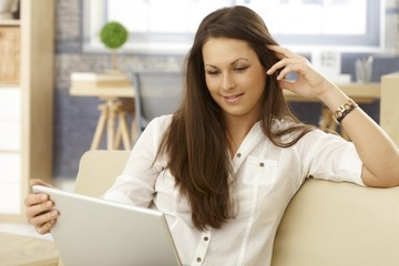 Young woman using laptop at home