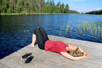 Young beautiful woman enjoy the nature of Finland