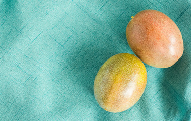 2 passion fruits on a green cloth with copy space