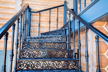 Black forged iron staircase close up