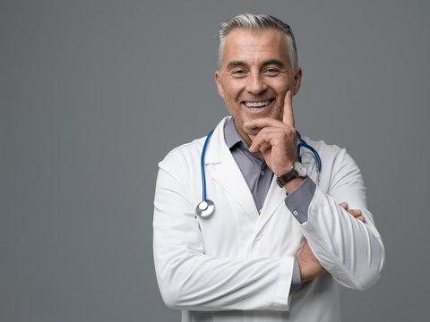 Smiling confident doctor portrait