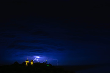Lightning stike over the chapel during the storm