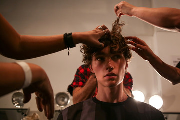 A model gets his hair done ahead of the Son Jung Wan Spring/Summer 2018 fashion show during New York Fashion Week in New York