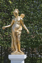 Gilded statue of a goddess in a park
