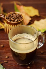 Delicious coffee and leaves of trees in autumn