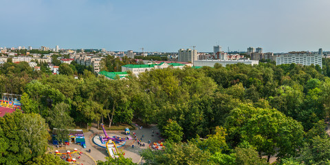 city public park of leisure and entertainment in the foreground of a panoramic view of the city. urban landscape