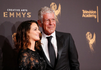 Chef Anthony Bourdain and actor Asia Argento pose at the 2017 Creative Arts Emmy Awards in Los Angeles
