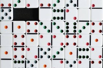 colorful domino texture with one space
