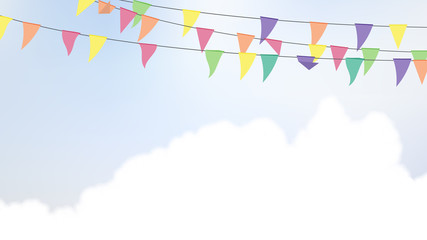 Celebration/party flags hanging in the air with bright blue sky and cloud background