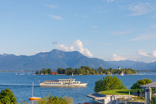 Ferry at Lake Chiemsee with Island Fraueninsel in Bavaria on a sunny summer day