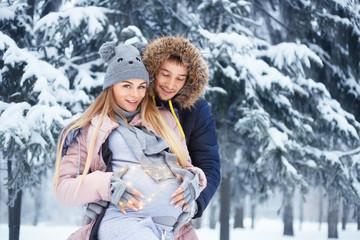 pregnant couple in winter