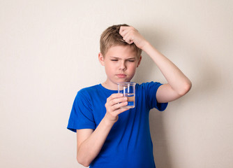 Boy observing a half full glass of water