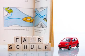 Fahrschule Führerschein Hintergrund mit Buch