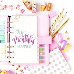 Monthly planner and stationery. Flat lay, top view
