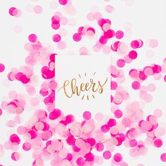 Pink paper confetti and empty card