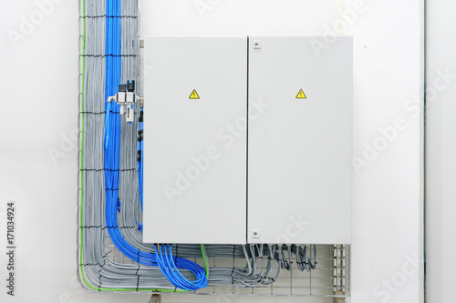 electricity distribution box with wires and circuit breakers (fuse box)