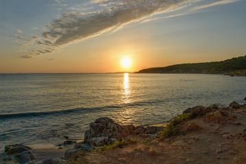In de dag Baksteen sunset in sant tomas, minorca, spain