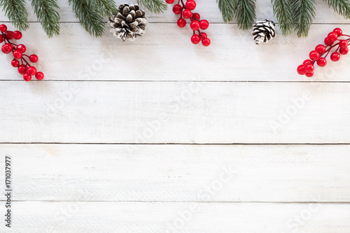 christmas and new year background with fir branches holly berry and pine cones on white