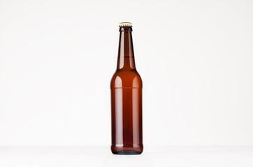 Brown longneck beer bottle mock up. Template for advertising, design, branding identity on white wood table.