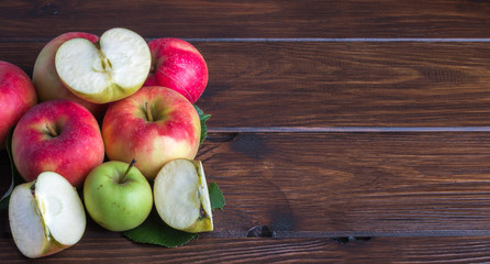 biological apples on a wooden table sliced