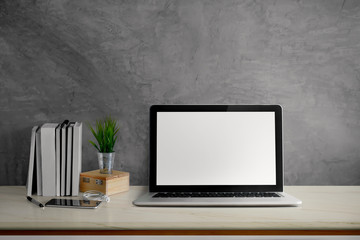 Wall Mural - Stylish workspace with blank screen laptop computer, office supplies, houseplant and books at office. desk work concept.