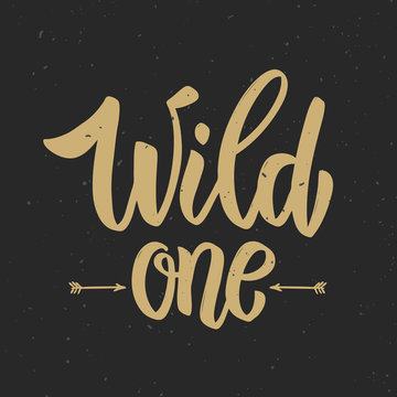 Wild one! Hand drawn lettering phrase on grunge background. Motivation quote.