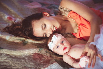 mom with daughter on bed