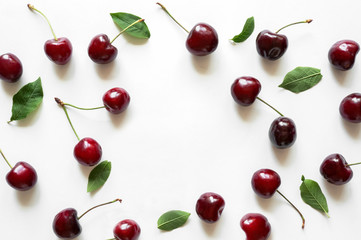 Creative fresh cherry pattern background with copy space. Isolated fruit.