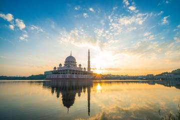 Sunrise moment at Putra Mosque, a principal mosque of Putrajaya, Malaysia. Construction of the mosque began in 1997 and was completed two years later.