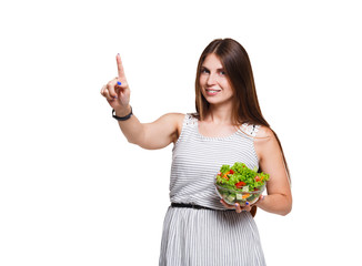 Young woman holding green salad isolated on white background.