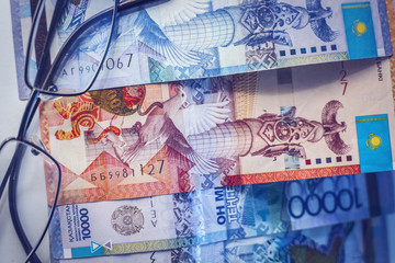 Kazakhstan money and glasses. Paper banknotes of tenge.