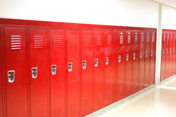 close up on red lockers in gym