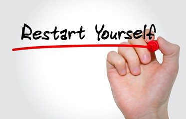 Hand writing inscription Restart Yourself with marker, concept