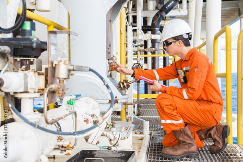 Mechanical engineer checking lube oil system of centrifugal