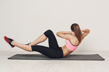 Fitness woman lying doing crunches