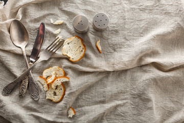 Cutlery With Bread And Spices On Old Fabric