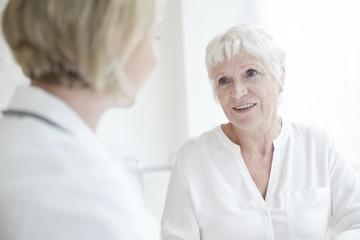 Senior woman listening to female doctor