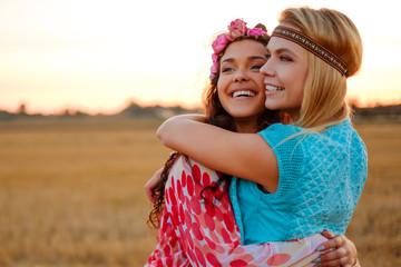 Hippie girls in a wheat field