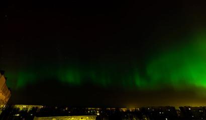 Intense northern lights (Aurora borealis) over city of Riga