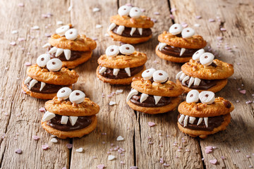 Halloween Dessert: funny monsters from cookies close-up. horizontal