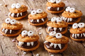 Toothed monsters of cookies close-up for Halloween. horizontal