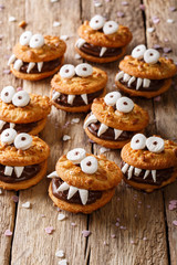 Peanuts chocolate cookies monsters close-up on a table for Halloween. vertical