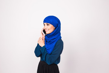 beautiful young arabian woman talking on cell phone.