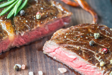 Beef steak with fresh rosemary on the wooden board