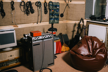 Old-fashioned recording studio with instruments. Hobby for hipsters in garage. Album making process, music concept