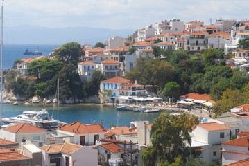 Poster Northern Europe Skiathos town on Skiathos Island, Greece. Beautiful view of the old town with boats in the harbor.