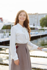 fashion portrait of happy beautiful girl in white shirt and casual dress