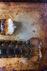 lobster tails closeup on rustic background