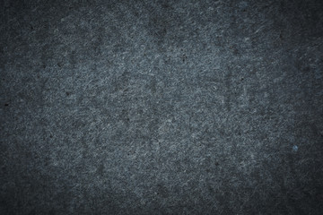 Rough texture of the stone. Gray shabby background.